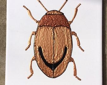 Ceramic Tile Painting, Original. Gold, copper and black bug beetle creepie crawley insect plaque
