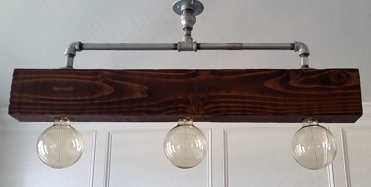Galvanized Pipe Chandelier With Rustic Wood Beam