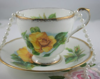 Large Yellow Rose Teacups & Saucer, Fine Bone China made by Paragon in England in 1960s.