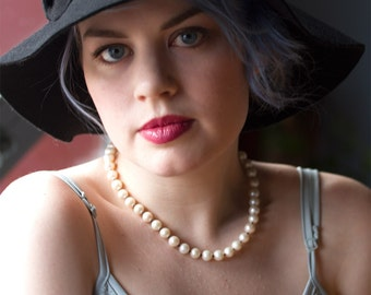 Pearl necklace, genuine pearl necklace, knotted pearl necklace; knotted pearls, freshwater pearls, sterling silver clasp