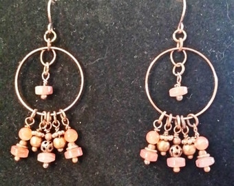 Copper chandelier earrings made with rose and copper beads