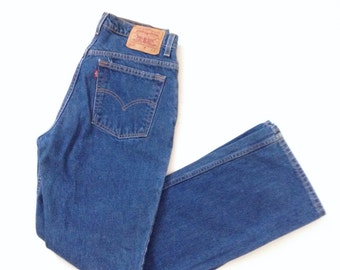 Levis 517 highwaisted, slim fit, natural wash boot cut jeans. 100% cotton jeans. W30 L33