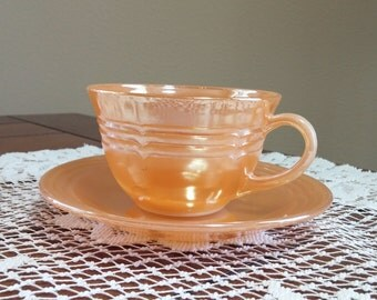 Fire King Peach Lusterware Tea Cup and Saucer
