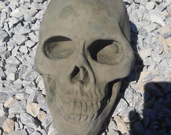 large concrete skull