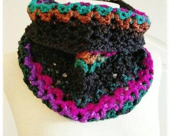 Soft neck fabric crochet in shades of black, green, Orange, and Fuchsia.