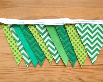 Garland felt, shades of Green Pennants. Decoration for St. Patrick, Easter, feast of child, child