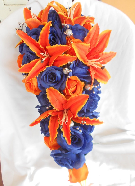 Orange and royal blue cascade bouquet 2 pc free toss Lilies and roses