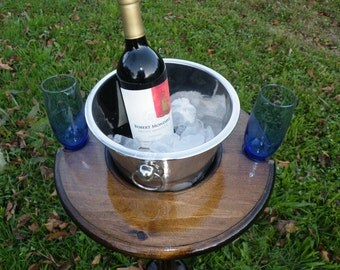 Outdoor wine table with ice bucket and wine glass holders