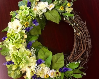 Grapevine wreath with beautiful hydrangeas, lavendar and other assorted silk flowers