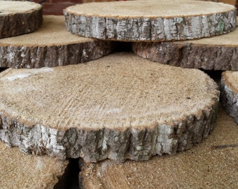 Set of 12 Poplar Wood slices or wood rounds 9 to 10 inches wide and an inch thick