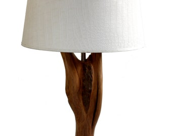 Unique table lamp made of weathered and partially modified Oak on a stone base.