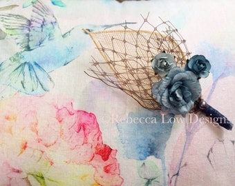 Groom dusty blue rose boutonniere with ivory sinamay leaf and brown birdcage veiling x 5
