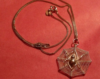 Silver spider in web pendant on silver chain
