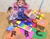 ooak dolls house little toddlergirl with her little interlocking soft play mat and 7 handmade toys. 112 scale