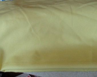 1+ yard of lemon yellow lightweight broadcloth with shlubbing