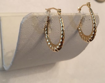 Vintage pair of small oval 14k yellow gold Shrimp Hoop Earrings with snap-down posts