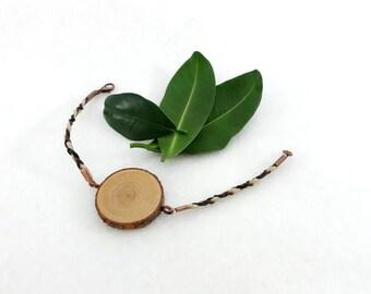 Wooden bracelet, wood slice on braided bracelet with hemp and leather