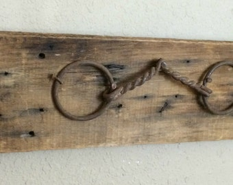 Repurposed vintage rusty horse bit on old barn board wall hanging home decor