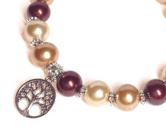 Handmade beaded bracelet.  Pearl Gold, Gold and Burgandy.  Silver coloured tree charm. A16W07