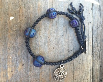 Square knot bracelet with clay beads