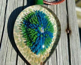 Glass implosion pendant with opal