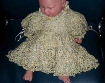 Beautiful handmade baby dress with ribbons and frills