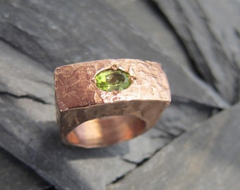 Pink gold Peridot ring designed by Stephane de Blaye, handcrafted in France.