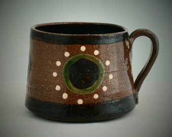 Scandinavian coffee mug. Wonderful earthenware mug with green motif and white highlights. Swedish studio pottery
