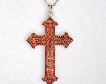 Amber orangey cross pendant with chain, enamelled