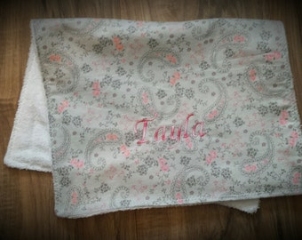 Personalized burp cloth made from flannel and terry cloth fabrics. Measures 19' × 12'.