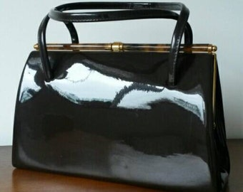 Brown Patent Leather Essell Handbag With Faux Tortoise Shell Clasp Detail