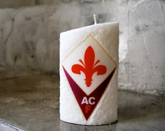Customized candle with the logo of favorite team.