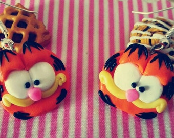A pair of earrings of Garfield made by my with Earrings Garfield fimo polymer clay