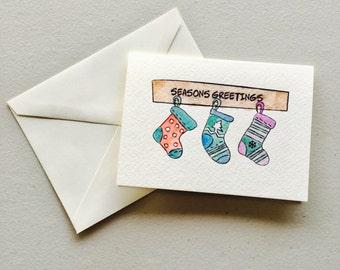 """Stockings """"Seasons Greetings"""" Watercolor Greeting Card"""