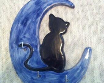 Hanger cat on Moon in handmade pottery