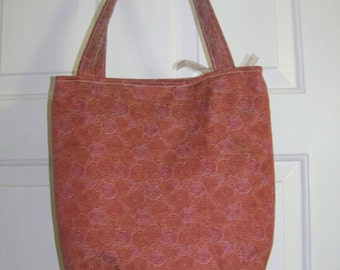 Tote bag in rust color with gold and white circle stitching