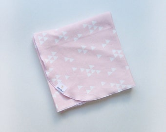 Pink and white triangle organic cotton knit swaddle blanket