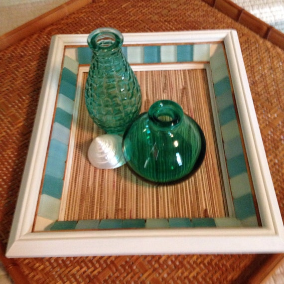 Rustic coastal centerpiece with glass tiles and bamboo trim