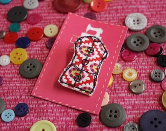 Free motion machine embroidered and appliqué Tailor's Dummy shaped brooch