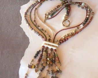 8-strand gemstone necklace with charms