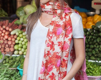 A vibrant and vivid floral printed shawl on raw silk perfect to cheer up any outfit for a festive occasion