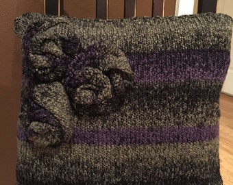 Green, purple and black sweater pillow