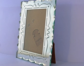 Charming Art Deco photo frame with bevelled mirror glass . aprox 1930's .
