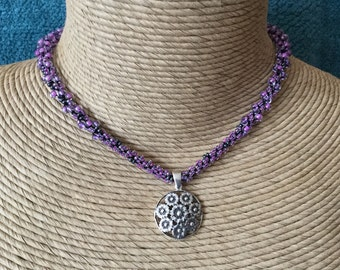 Purple glass beaded crocheted necklace with sterling silver pendant