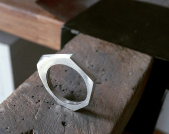 Silver asymmetric ring
