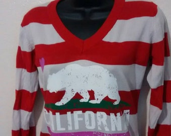 Red stripes and bear sweater