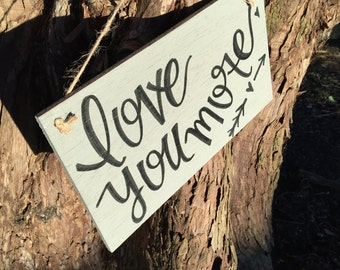 Love you more hanging sign