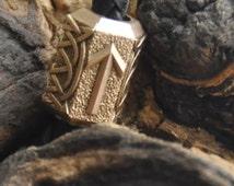 Bead with runes. Bead on the bracelet. A set of runes. Clip on the beard.