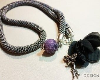 Beaded necklace rope desorated with agate stone bead