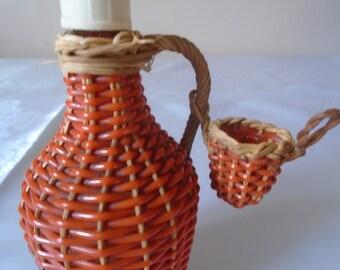 Rynbende cherry brandy 6''  plastic coated woven bottle.